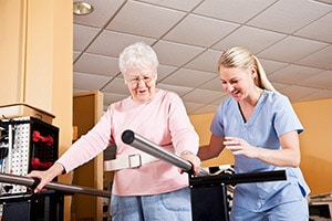 Nurse helping patient with balance while walking
