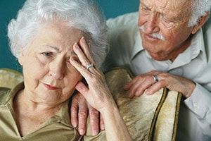 Two elderly people consoling eachother