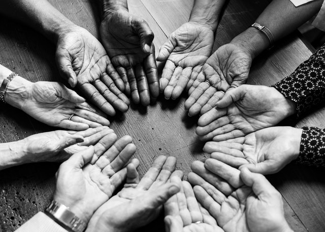 circle made of our people's hands